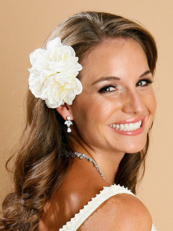 Which wedding hairstyles with flowers are trendy loshairos two flowers in hair mightylinksfo